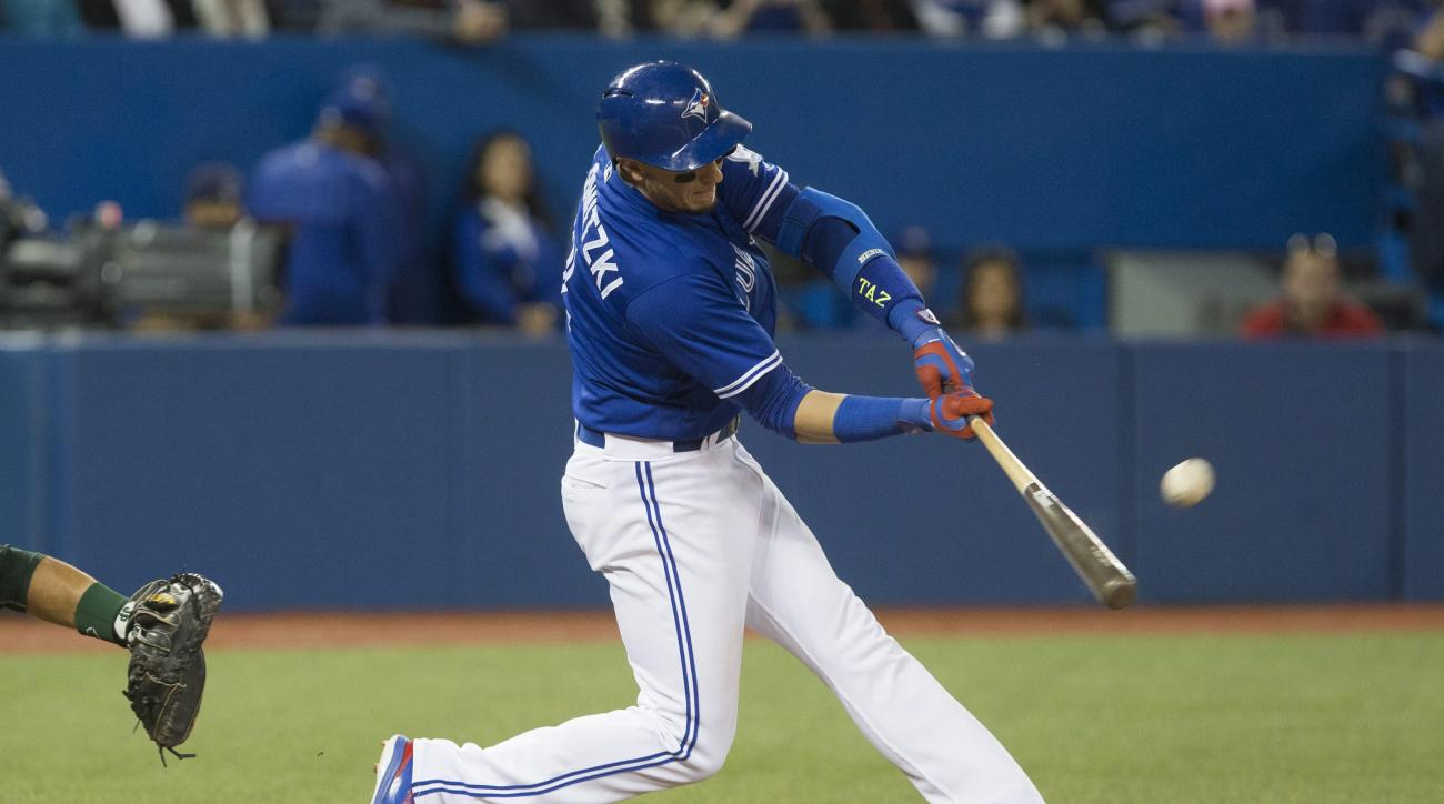 Toronto Blue Jays' Troy Tulowitzki hits a solo home run off during the fifth inning of a baseball game against the Oakland Athletics in Toronto on Saturday, April 23, 2016. (Chris Young/The Canadian Press via AP) MANDATORY CREDIT