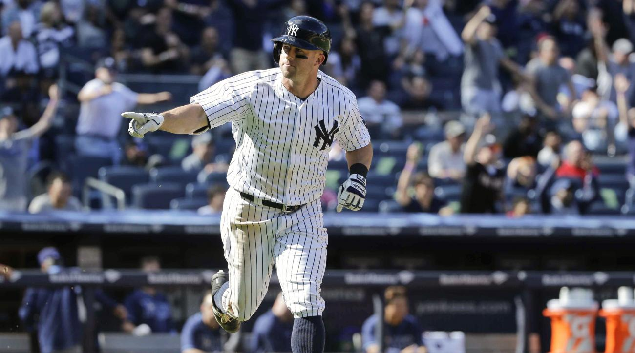 New York Yankees' Brett Gardner points to his dugout as he runs the bases after hitting a walk-off home run during the ninth inning of a baseball game against the Tampa Bay Rays Saturday, April 23, 2016, in New York. The Yankees won 3-2. (AP Photo/Frank F