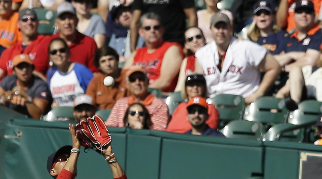 Boston Red Sox right fielder Mookie Betts, left, makes the catch as Dustin Pedroia (15) ducks down for the out on Houston Astros' Carlos Gomez in the fourth inning of a baseball game Saturday, April 23, 2016, in Houston. (AP Photo/Pat Sullivan)