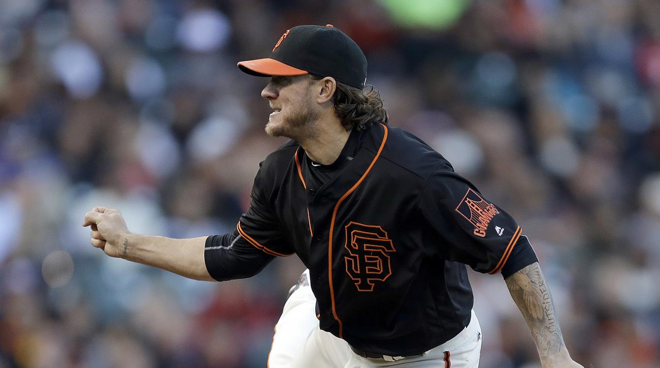 San Francisco Giants pitcher Jake Peavy works watches a delivery to the Miami Marlins during the first inning of a baseball game Saturday, April 23, 2016, in San Francisco. (AP Photo/Ben Margot)