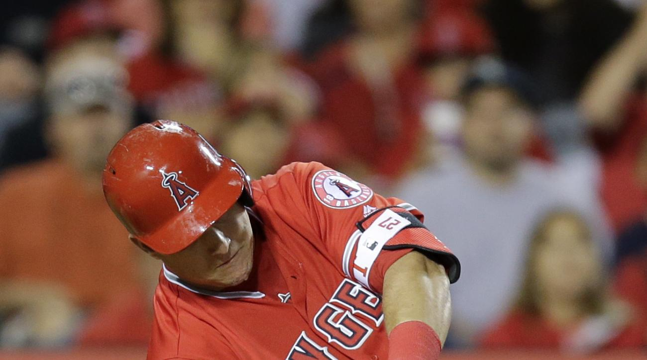 Los Angeles Angels' Mike Trout hits a two-run home run during the sixth inning of a baseball game against the Seattle Mariners, Saturday, April 23, 2016, in Anaheim, Calif. (AP Photo/Jae C. Hong)