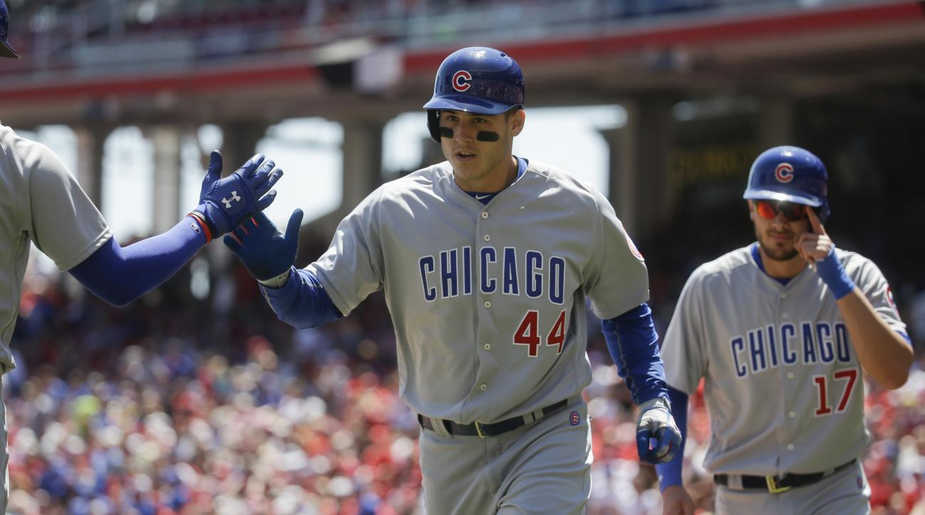 Chicago Cubs' Anthony Rizzo (44) celebrates as he runs back to the dugout following his second two-run home run off Cincinnati Reds starting pitcher Alfredo Simon in the third inning of a baseball game, Sunday, April 24, 2016, in Cincinnati. (AP Photo/Joh