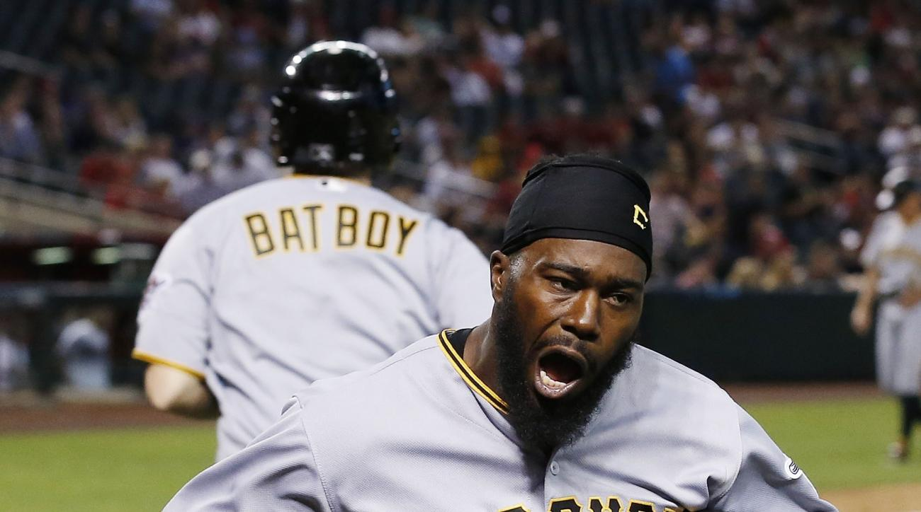 Pittsburgh Pirates' Josh Harrison shouts in celebration after scoring a run against the Arizona Diamondbacks during the 13th inning of a baseball game Sunday, April 24, 2016, in Phoenix. The Pirates defeated the Diamondbacks 12-10. (AP Photo/Ross D. Frank