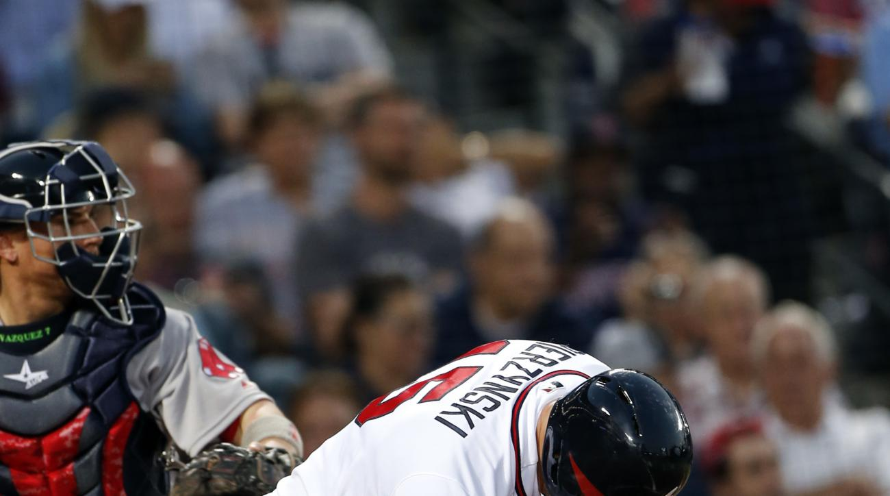 Atlanta Braves' A.J. Pierzynski (15) breaks his bat after striking out in the fourth inning of a baseball game against the Boston Red Sox Monday, April 25, 2016, in Atlanta. (AP Photo/John Bazemore)