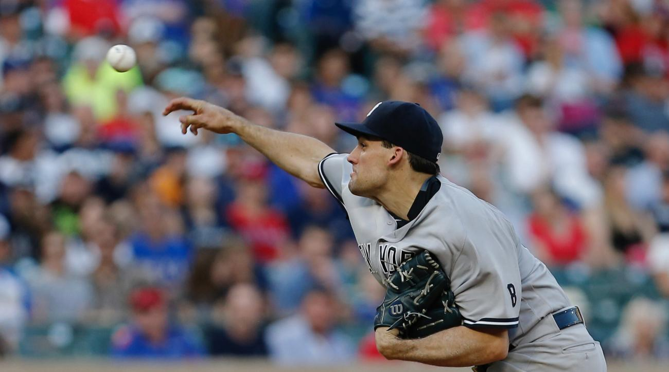 New York Yankees starting pitcher Nathan Eovaldi (30) throws during the first inning of a baseball game against the Texas Rangers on Monday, April 25, 2016, in Arlington, Texas. (AP Photo/Brandon Wade)