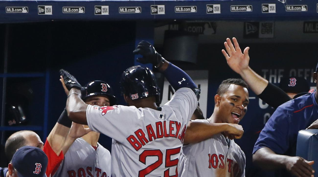 Boston Red Sox center fielder Jackie Bradley Jr. (25) celebrates with Xander Bogaerts, right, after hitting a solo home run against the Atlanta Braves in a baseball game Monday, April 25, 2016, in Atlanta. (AP Photo/John Bazemore)