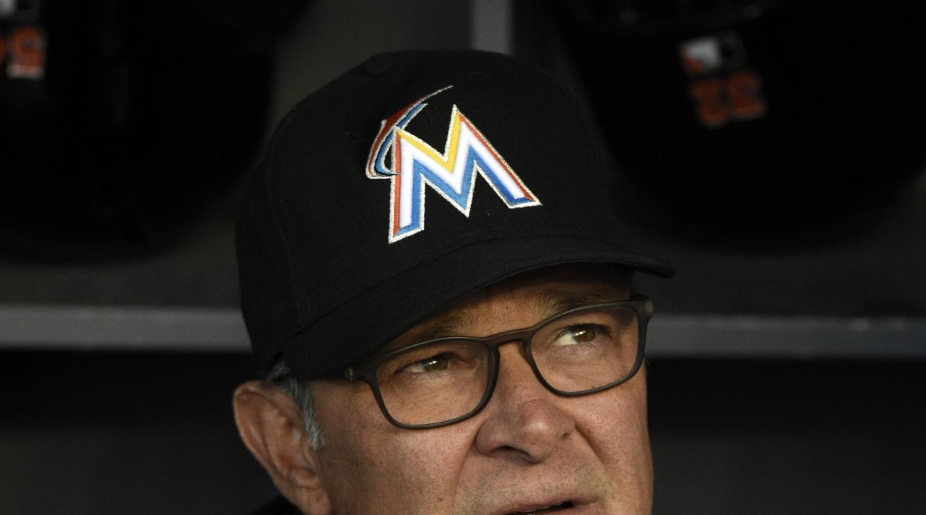 Miami Marlins manager Don Mattingly sits in the dugout prior to a baseball game against the Los Angeles Dodgers in Los Angeles, Monday, April 25, 2016. (AP Photo/Kelvin Kuo)