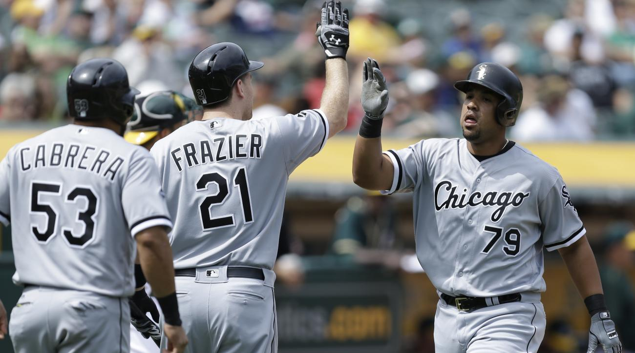 FILE - In this Thursday, April 7, 2016 file photo, Chicago White Sox's Jose Abreu, right, is congratulated by Todd Frazier (21) and Melky Cabrera (53) after hitting a two run home run off Oakland Athletics' Kendall Graveman in the sixth inning of a baseba