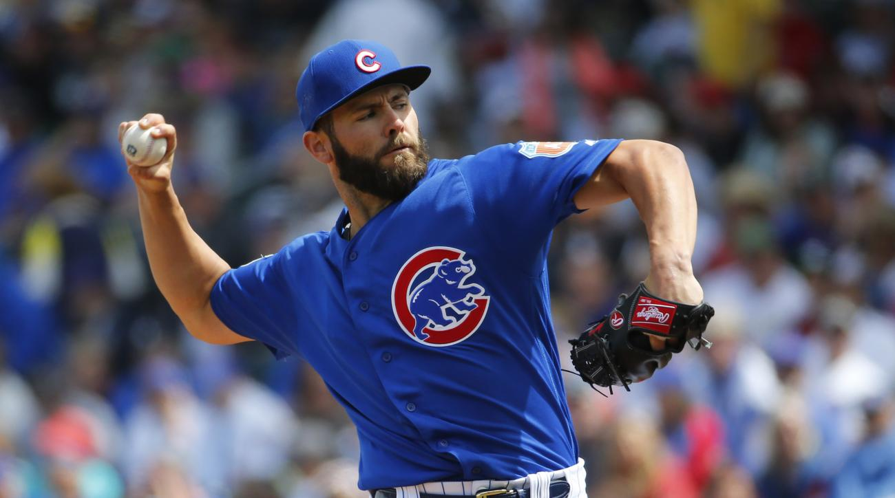 """FILE - In this March 29, 2016, file photo, Chicago Cubs pitcher Jake Arrieta throws against the Oakland Athletics during a spring training baseball game in Mesa, Ariz. Arrieta says it is """"flattering"""" that """"some of the best players in the game"""" are spreadi"""