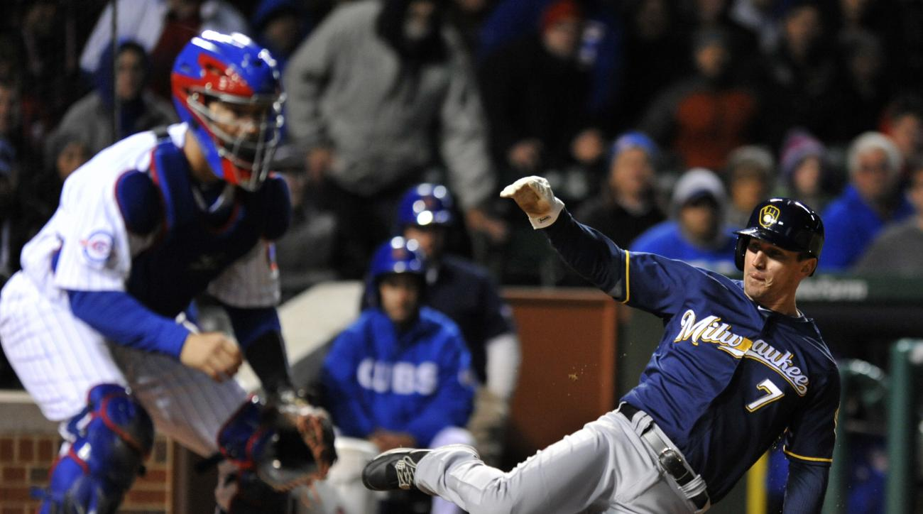 Milwaukee Brewers' Colin Walsh (7) slides safely into home plate on a Ryan Braun two-RBI double while Chicago Cubs catcher David Ross waits for the throw during the eighth inning of a baseball game Tuesday, April 26, 2016, in Chicago. (AP Photo/Paul Beaty