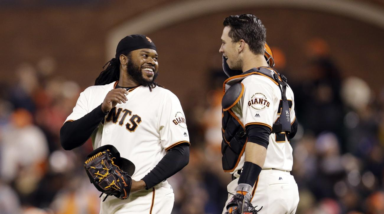 San Francisco Giants starting pitcher Johnny Cueto, left, celebrates with catcher Buster Posey after Cueto pitched a seven-hit shutout against the San Diego Padres during a baseball game Tuesday, April 26, 2016, in San Francisco. San Francisco won 1-0. (A