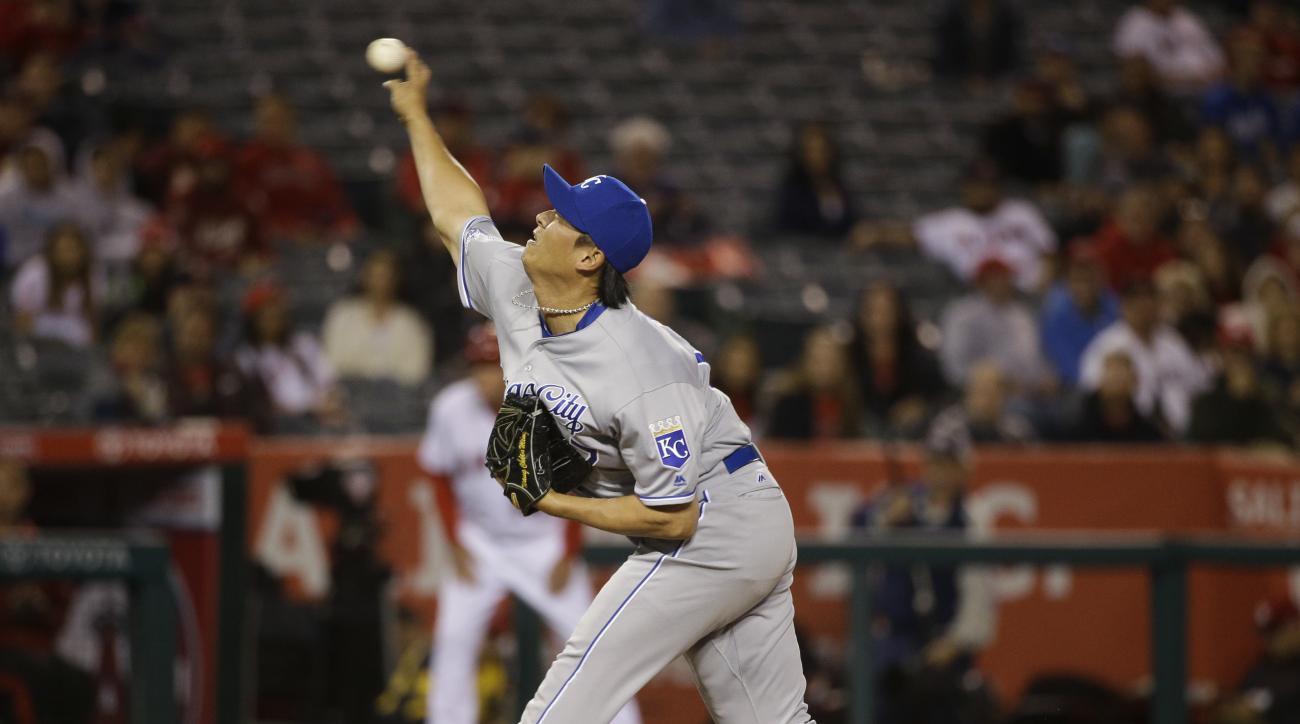 Kansas City Royals relief pitcher Chien-Ming Wang, of Taiwan, throws against the Los Angeles Angels during the eighth inning of a baseball game, Tuesday, April 26, 2016, in Anaheim, Calif. (AP Photo/Jae C. Hong)