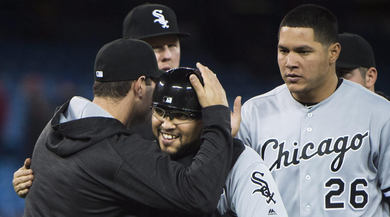 Chicago White Sox catcher Dioner Navarro celebrates with teammates after the White Sox defeated the Toronto Blue Jays 4-0 in a baseball game Wednesday, April 27, 2016, in Toronto. (Nathan Denette/The Canadian Press via AP)