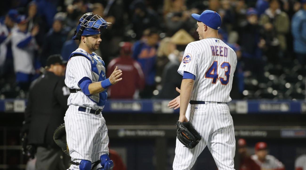 New York Mets catcher Kevin Plawecki, left, congratulates Mets relief pitcher Addison Reed (43) after Reed closed out the Mets 5-3 victory over the Cincinnati Reds to earn the save in a baseball game Wednesday, April 27, 2016, in New York. The Mets swept
