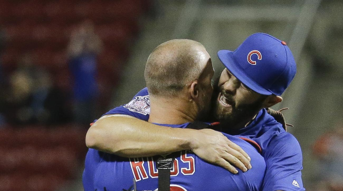 FILE - In this April 21, 2016, file photo, Chicago Cubs starting pitcher Jake Arrieta, right, celebrates with catcher David Ross after the final out of his no-hitter baseball game against the Cincinnati Reds in Cincinnati. Expectations for both Chicago ba