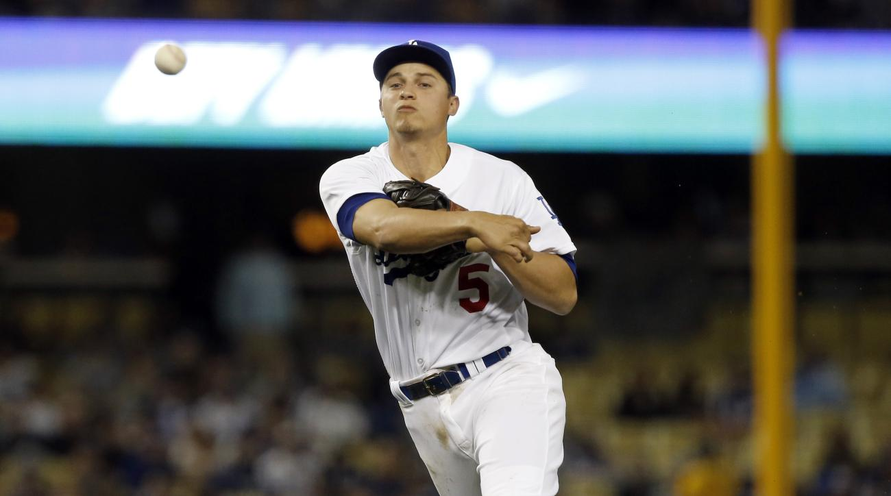 Los Angeles Dodgers shortstop Corey Seager throws out Miami Marlins' Christian Yelich at first on a ground ball during the seventh inning of a baseball game in Los Angeles, Wednesday, April 27, 2016. (AP Photo/Alex Gallardo)