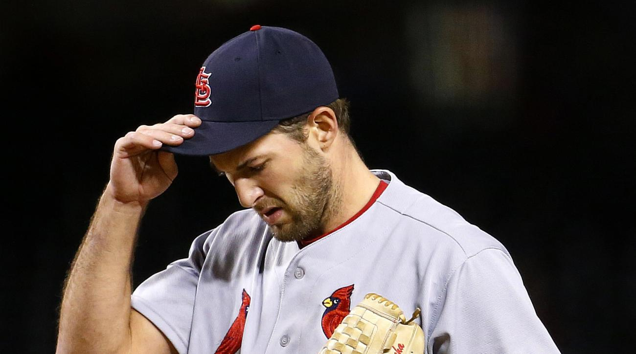 St. Louis Cardinals starting pitcher Michael Wacha adjusts his cap after giving up a home run to the Arizona Diamondbacks during the fourth inning of a baseball game Thursday, April 28, 2016, in Phoenix. (AP Photo/Matt York)