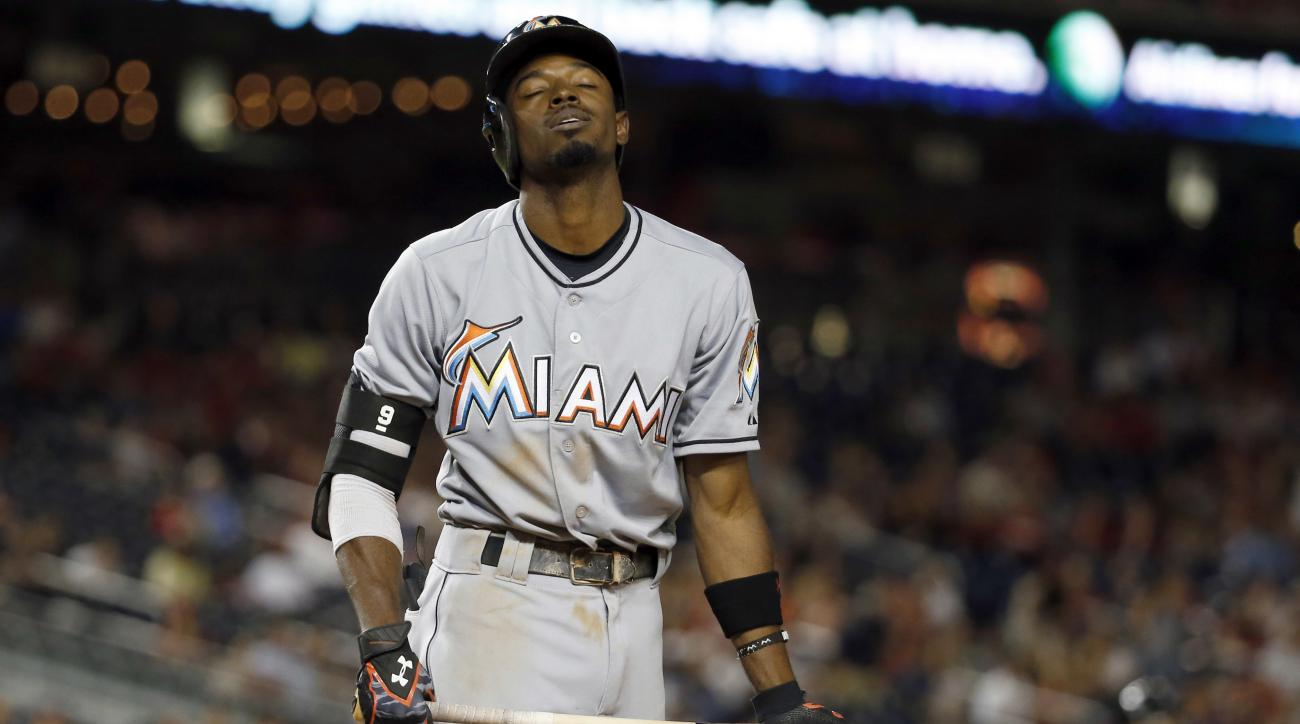 FILE - In this Sept. 18, 2015 file photo, Miami Marlins' Dee Gordon reacts after a strike while batting during the ninth inning of a baseball game against the Washington Nationals at Nationals Park, in Washington. Reigning NL batting champion Dee Gordon s