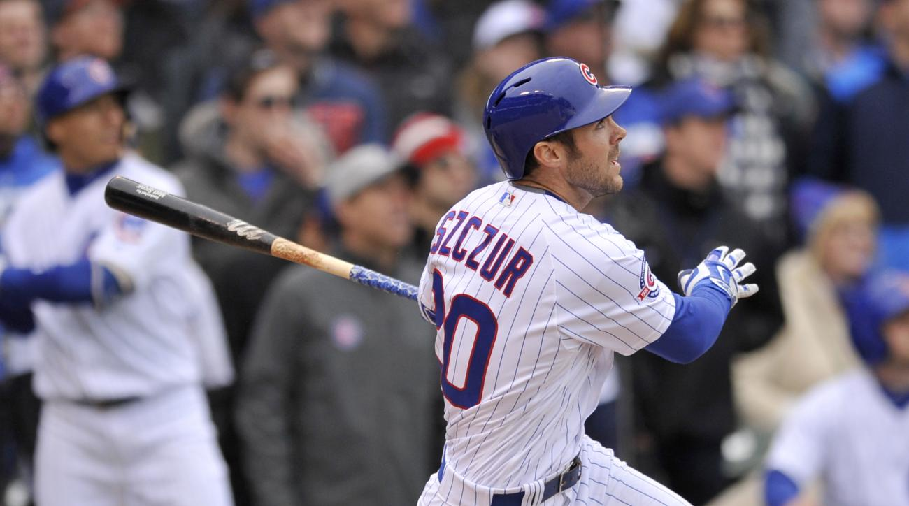Chicago Cubs' Matt Szczur watches his grand slam during the eighth inning a baseball game against the Atlanta Braves, Friday, April 29, 2016, in Chicago. (AP Photo/Paul Beaty)