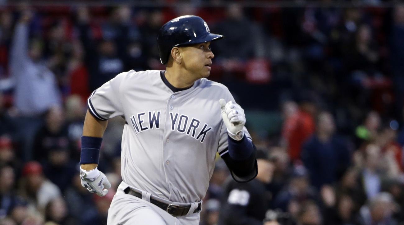 New York Yankees designated hitter Alex Rodriguez runs after hitting a solo home run against the Boston Red Sox during the second inning of a baseball game at Fenway Park on Friday, April 29, 2016, in Boston. (AP Photo/Elise Amendola)