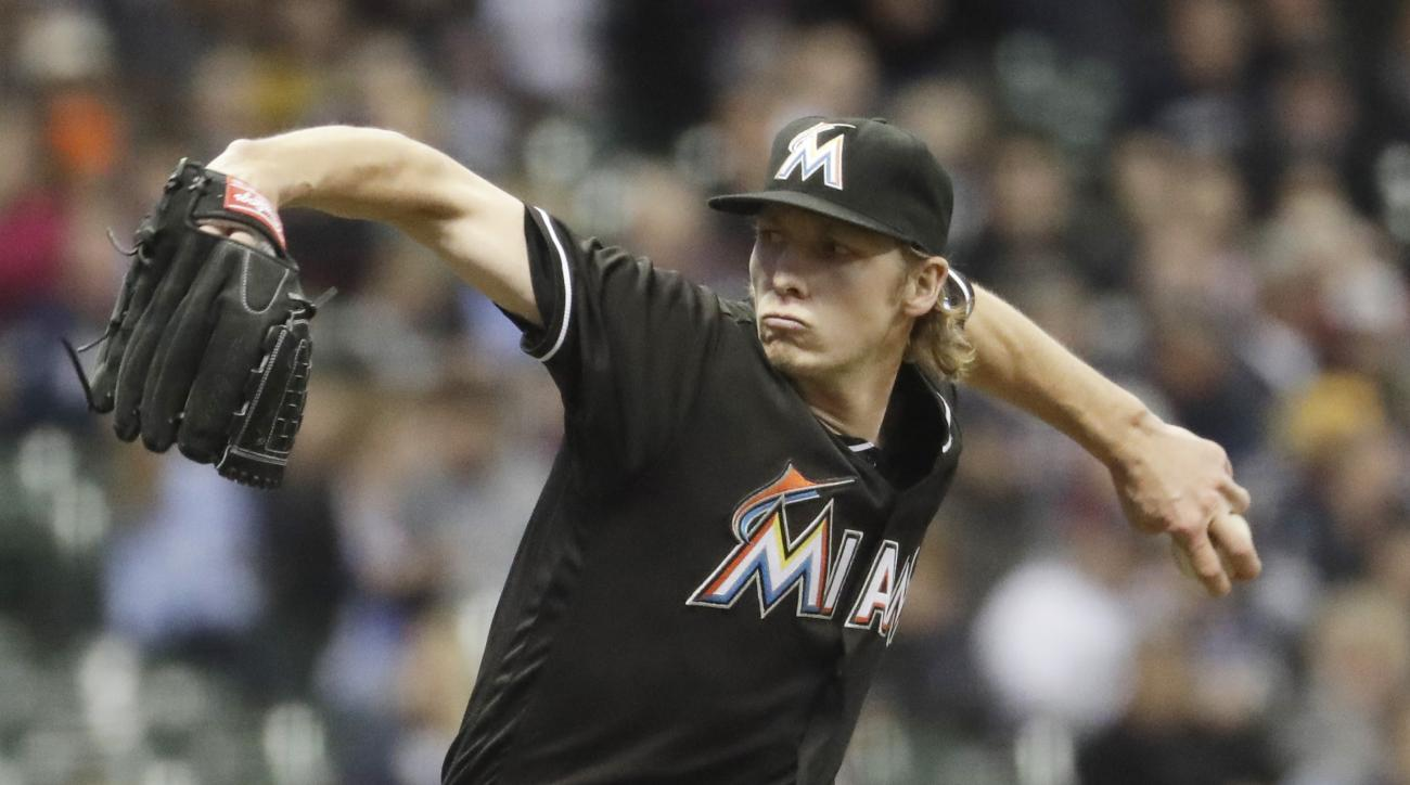 Miami Marlins starting pitcher Adam Conley throws during the first inning of a baseball game against the Milwaukee Brewers Friday, April 29, 2016, in Milwaukee. (AP Photo/Morry Gash)