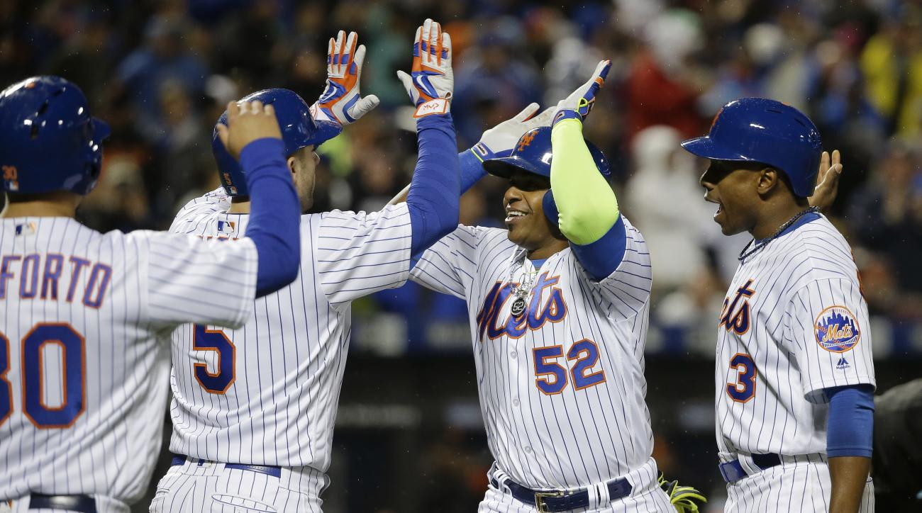 New York Mets' Yoenis Cespedes (52) is greeted by David Wright (5), Curtis Granderson (3) and Michael Conforto (30) after hitting a grand slam against the San Francisco Giants during the third inning of a baseball game, Friday, April 29, 2016, in, New Yor