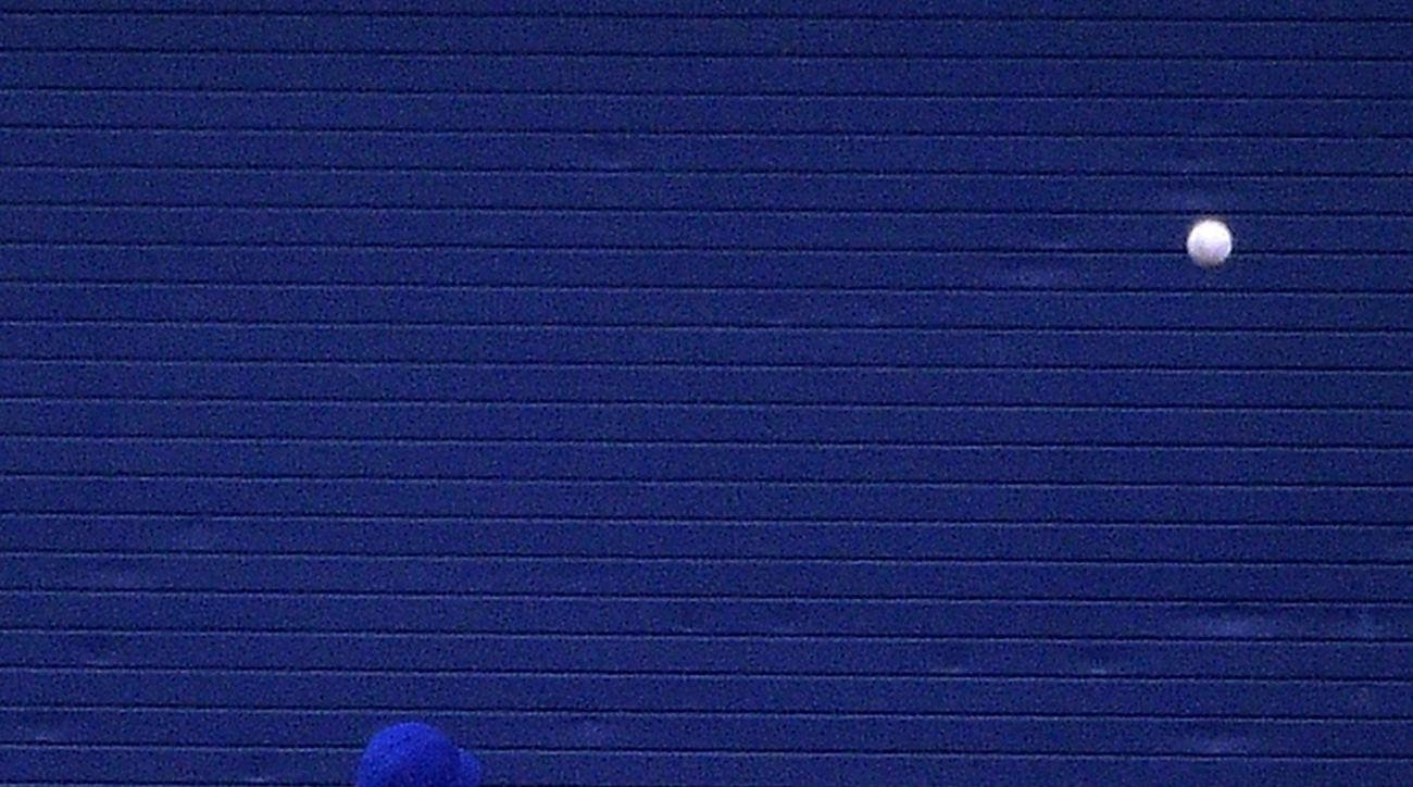 Toronto Blue Jays center fielder Kevin Pillar (11) watches as a solo home run by Tampa Bay Rays' Logan Forsythe flies over the wall during the seventh inning of a baseball game in St. Petersburg, Fla., Saturday, April 30, 2016. (AP Photo/Phelan M. Ebenhac
