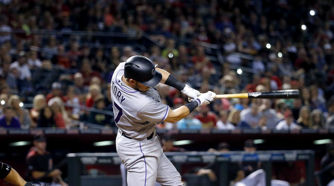 Colorado Rockies' Trevor Story connects for a two-RBI triple against the Arizona Diamondbacks during the ninth inning of a baseball game, Saturday, April 30, 2016, in Phoenix. (AP Photo/Matt York)