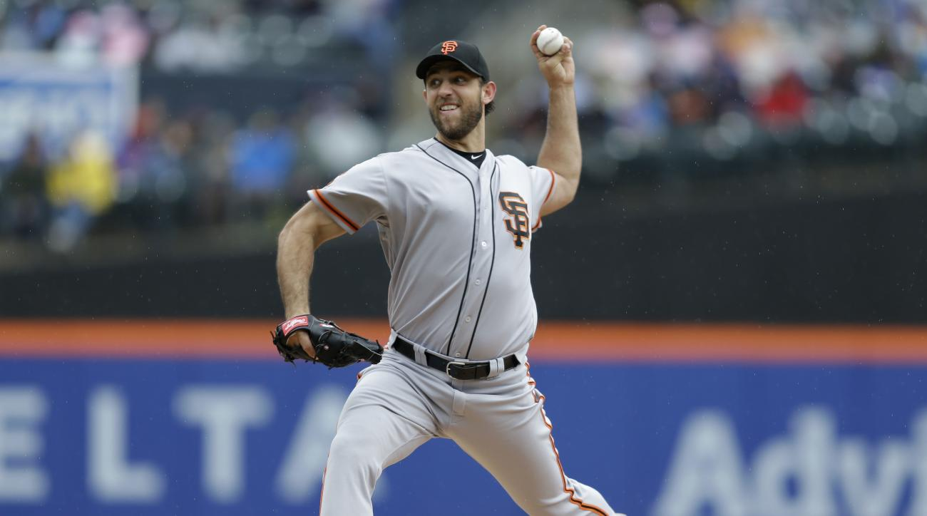 San Francisco Giants starting pitcher Madison Bumgarner throws during the second inning of the baseball game against the New York Mets at Citi Field, Sunday, May 1, 2016 in New York. (AP Photo/Seth Wenig)