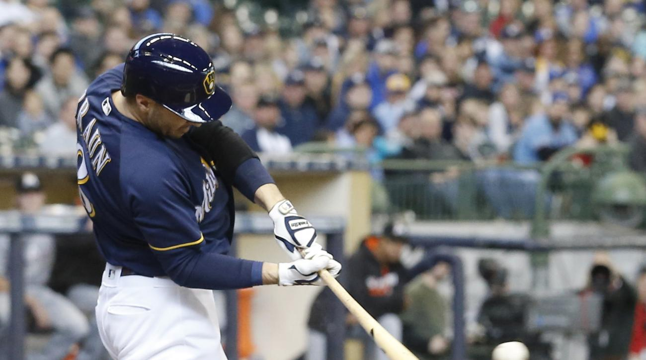 Milwaukee Brewers' Ryan Braun hits an RBI single during the first inning of a baseball game against the Miami Marlins Sunday, May 1, 2016, in Milwaukee. (AP Photo/Morry Gash)