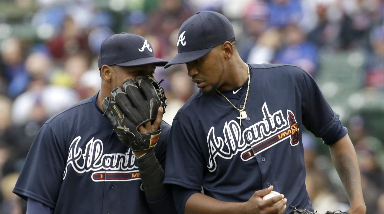 Atlanta Braves starter Julio Teheran, right, listens to shortstop Erick Aybar during the first inning of a baseball game against the Chicago Cubs, Sunday, May 1, 2016, in Chicago. (AP Photo/Nam Y. Huh)