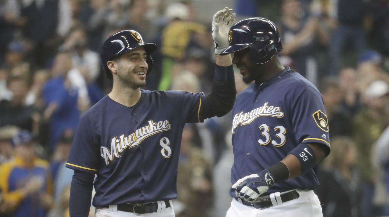 Milwaukee Brewers' Chris Carter (33) is congratulated by Ryan Braun after hitting a two-run home run during the third inning of a baseball game against the Miami Marlins Sunday, May 1, 2016, in Milwaukee. (AP Photo/Morry Gash)