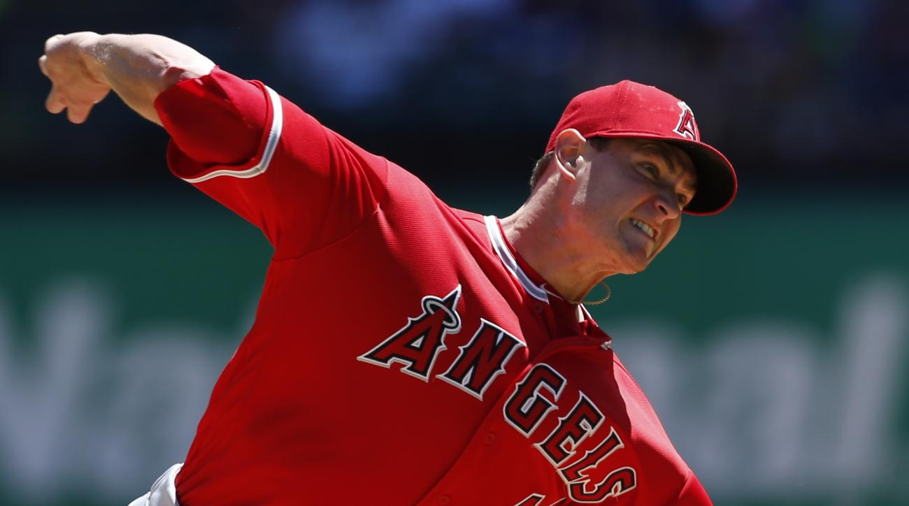 Los Angeles Angels starting pitcher Garrett Richards delivers to the Texas Rangers during the first inning of a baseball game, Sunday, May 1, 2016, in Arlington, Texas. (AP Photo/Jim Cowsert)