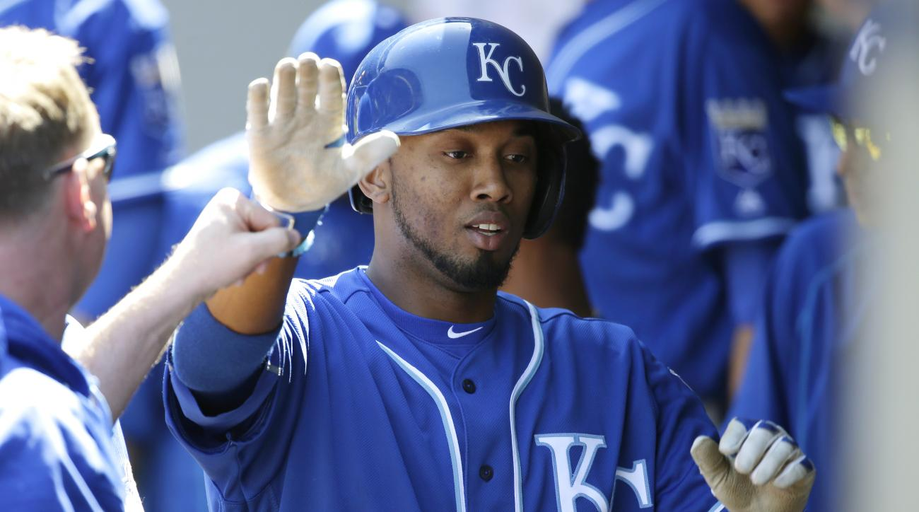Kansas City Royals' Alcides Escobar is greeted in the dugout after he scored on an RBI single hit by Royals' Lorenzo Cain in the third inning of a baseball game, Sunday, May 1, 2016, in Seattle. (AP Photo/Ted S. Warren)