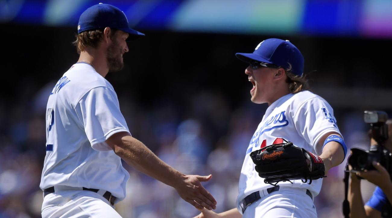 Los Angeles Dodgers' Enrique Hernandez, right, congratulates starting pitcher Clayton Kershaw after they defeated the San Diego Padres in a baseball game, Sunday, May 1, 2016, in Los Angeles. (AP Photo/Mark J. Terrill)