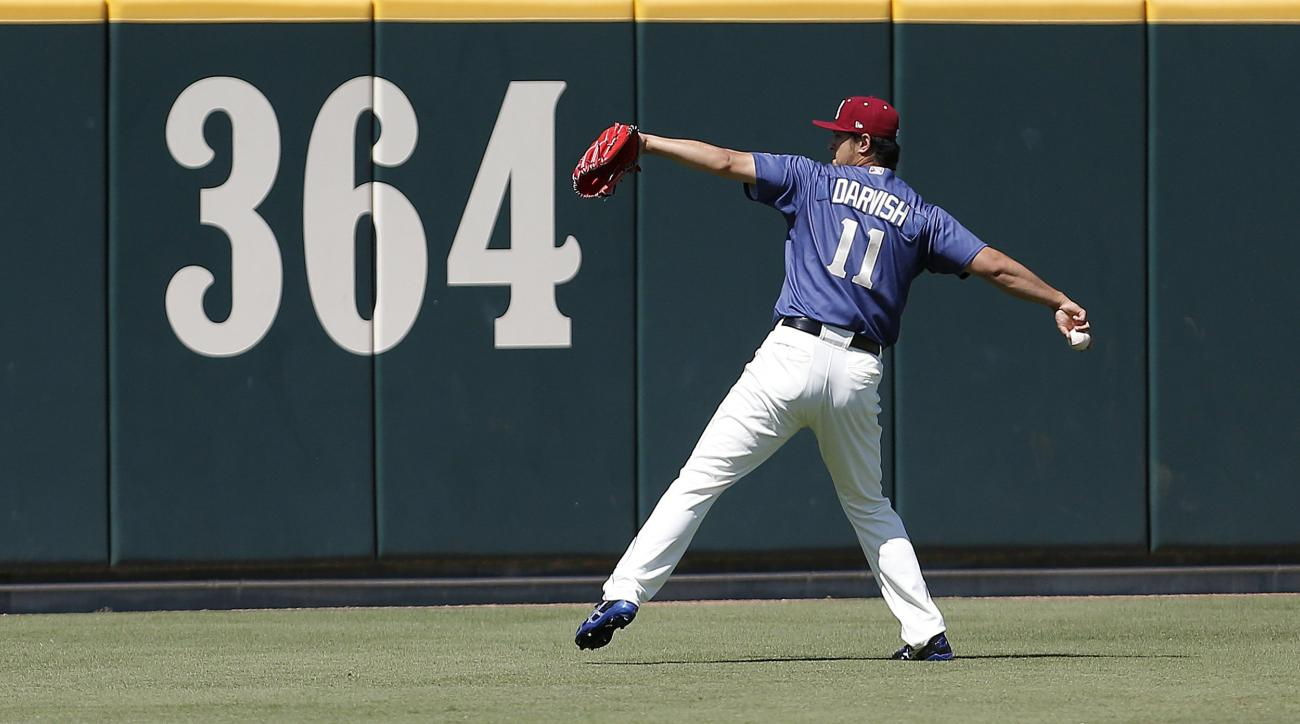Rehabbing with the Frisco Rough Riders, Texas Rangers starting pitcher Yu Darvish warms up in the outfield before a Double-A baseball game against the Corpus Christi Hooks at Dr. Pepper Ballpark in Frisco, Texas, Sunday, May 1, 2016. (Brandon Wade/Star-Te