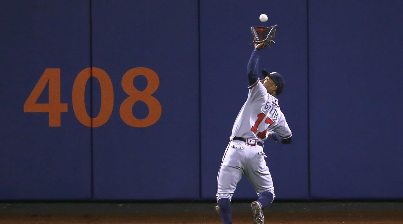 Atlanta Braves center fielder Mallex Smith (17) makes an over the shoulder catch in the seventh-inning, of a baseball game against the New York Mets, Monday, May 2, 2016, in New York. (AP Photo/Kathy Willens)