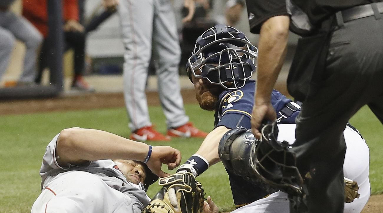 Los Angeles Angels' Albert Pujols slides safely under the tag of Milwaukee Brewers catcher Jonathan Lucroy during the eighth inning of a baseball game Monday, May 2, 2016, in Milwaukee. Pujols scored from second on a hit by C.J. Cron. (AP Photo/Morry Gash