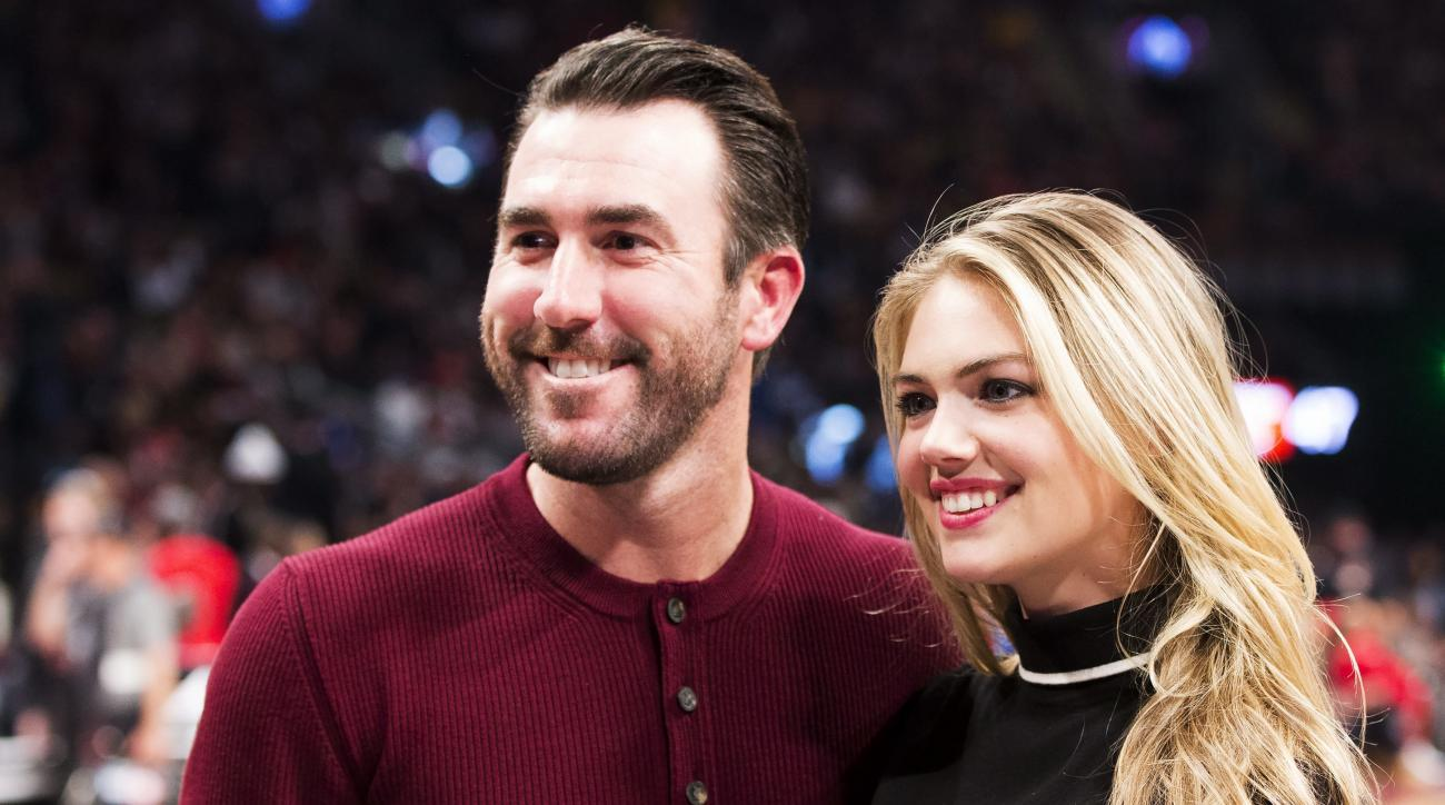 FILE - This is a Feb. 14, 2016 file photo showing Detroit Tigers pitcher Justin Verlander and model Kate Upton posed during halftime at the NBA All-Star basketball game  in Toronto. Upton has announced her engagement to baseball star Justin Verlander. The