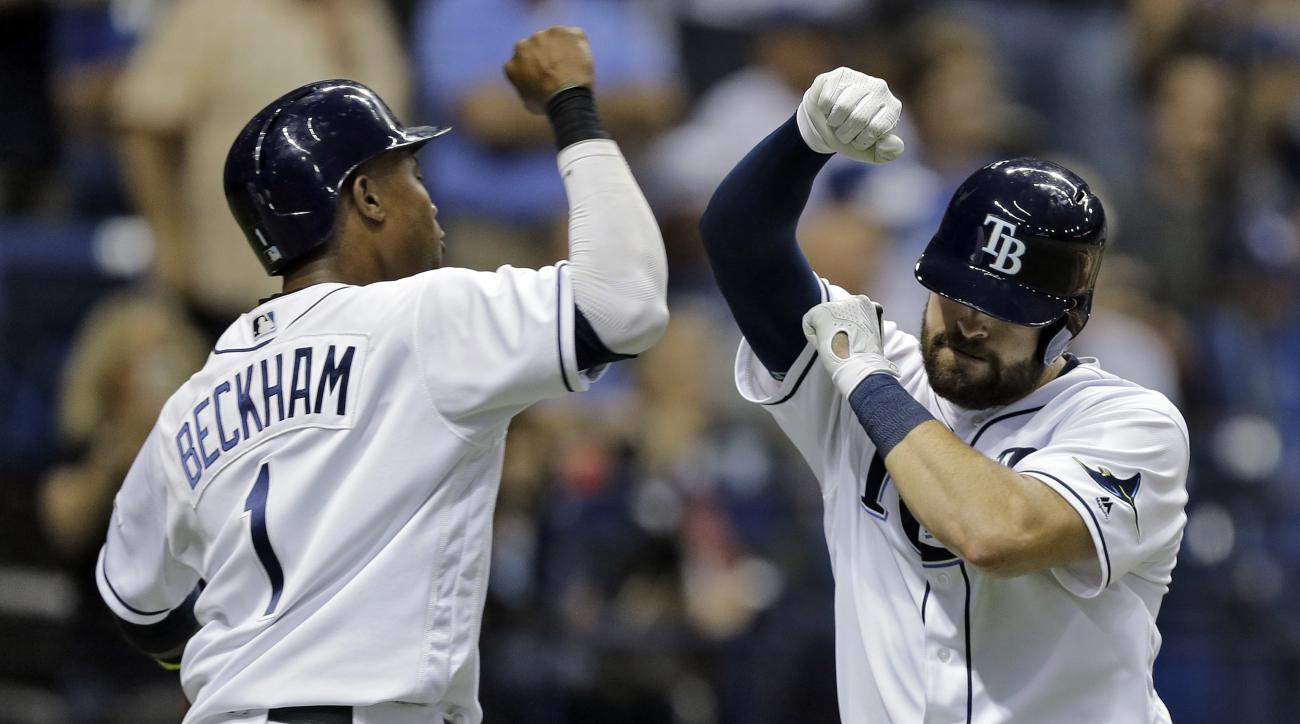 Tampa Bay Rays' Curt Casali, right, celebrates with Tim Beckham after Casili hit a two-run home run off Los Angeles Dodgers starting pitcher Scott Kazmir during the fourth inning of an interleague baseball game Tuesday, May 3, 2016, in St. Petersburg, Fla