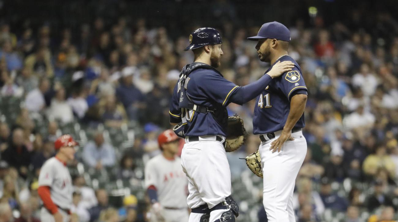 Milwaukee Brewers catcher Jonathan Lucroy talks to starting pitcher Junior Guerra after a balk during the third inning of a baseball game against the Los Angeles Angels Tuesday, May 3, 2016, in Milwaukee. (AP Photo/Morry Gash)