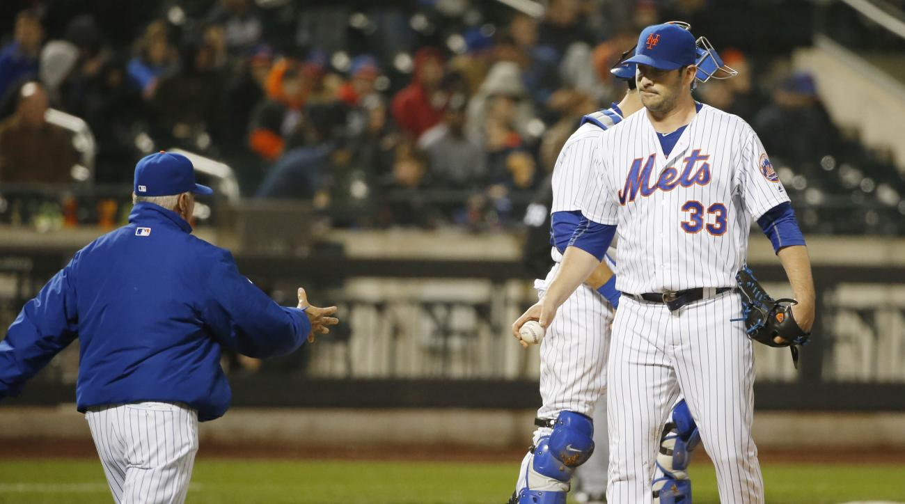 New York Mets manager Terry Collins, left, heads to the mound to take the ball from New York Mets starting pitcher Matt Harvey (33) during the sixth inning of a baseball game against the Atlanta Braves, Tuesday, May 3, 2016, in New York. Harvey threw a wi