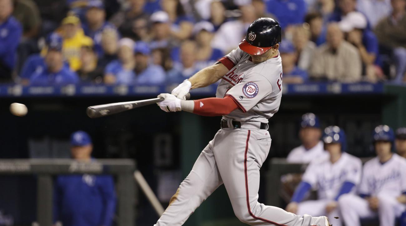 Washington Nationals Danny Espinosa hits a sacrifice fly to score the go-ahead run in the sixth inning of a baseball game against the Kansas City Royals at Kauffman Stadium in Kansas City, Mo., Tuesday, May 3, 2016. (AP Photo/Colin E. Braley)