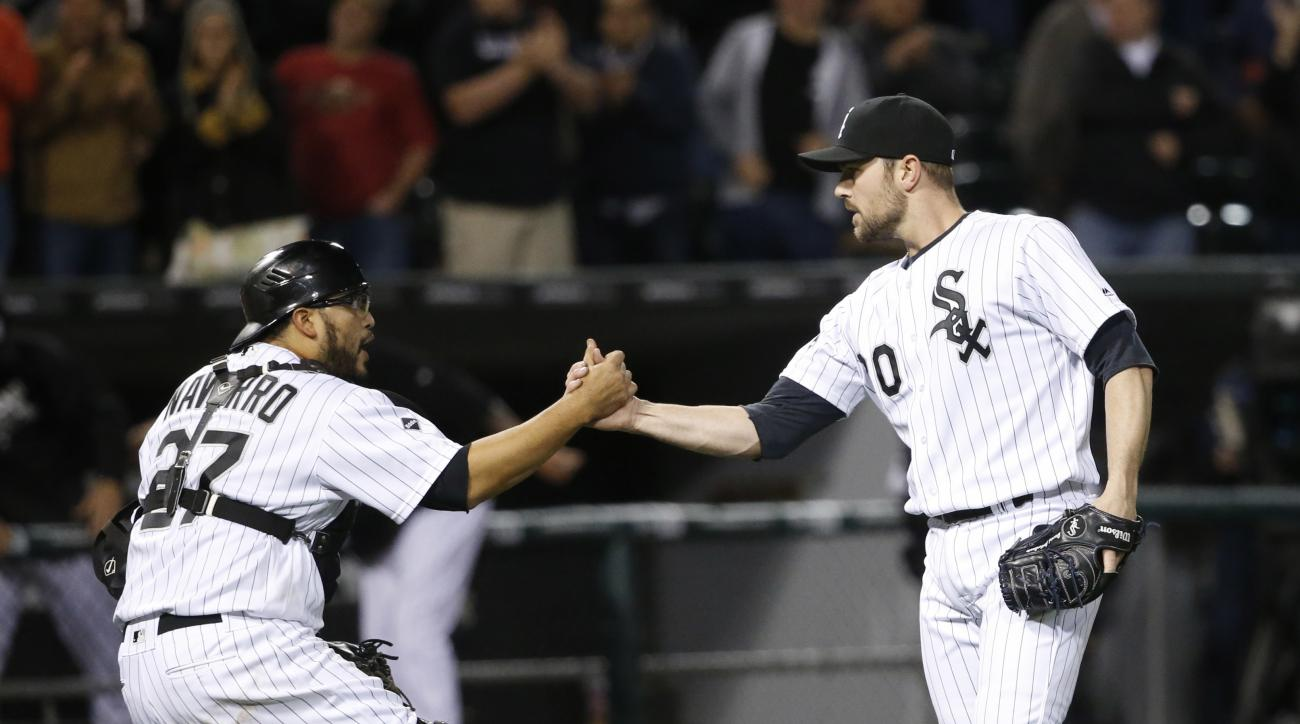 Chicago White Sox catcher Dioner Navarro, left, and relief pitcher David Robertson celebrate the White Sox's 4-1 win over Boston Red Sox after a baseball game Tuesday, May 3, 2016, in Chicago. (AP Photo/Charles Rex Arbogast)