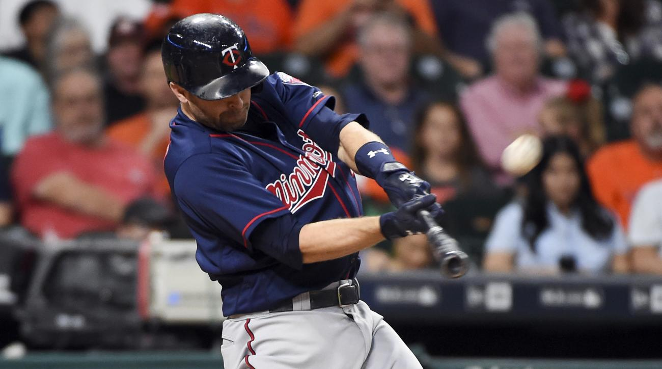 Minnesota Twins' Brian Dozier hits a three-run home run off of Houston Astros starting pitcher Mike Fiers in the third inning of a baseball game, Wednesday, May 4, 2016, in Houston. (AP Photo/Eric Christian Smith)
