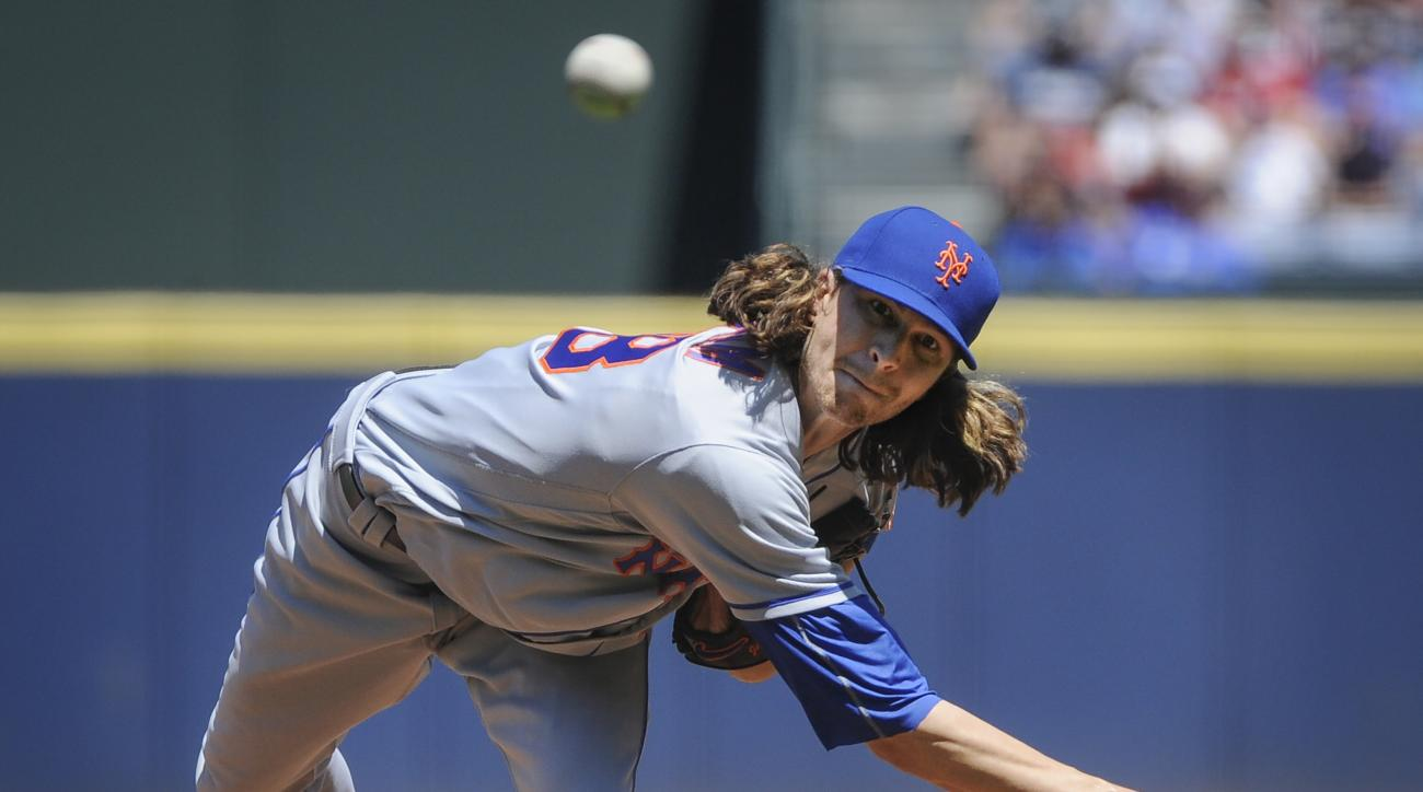 FILE - In this Sunday, April 24, 2016 file photo, New York Mets' Jacob deGrom pitches against the Atlanta Braves during the first inning of a baseball game in Atlanta. Jacob deGrom, who carries a 3-0 record and 1.02 ERA into his start at San Diego, often
