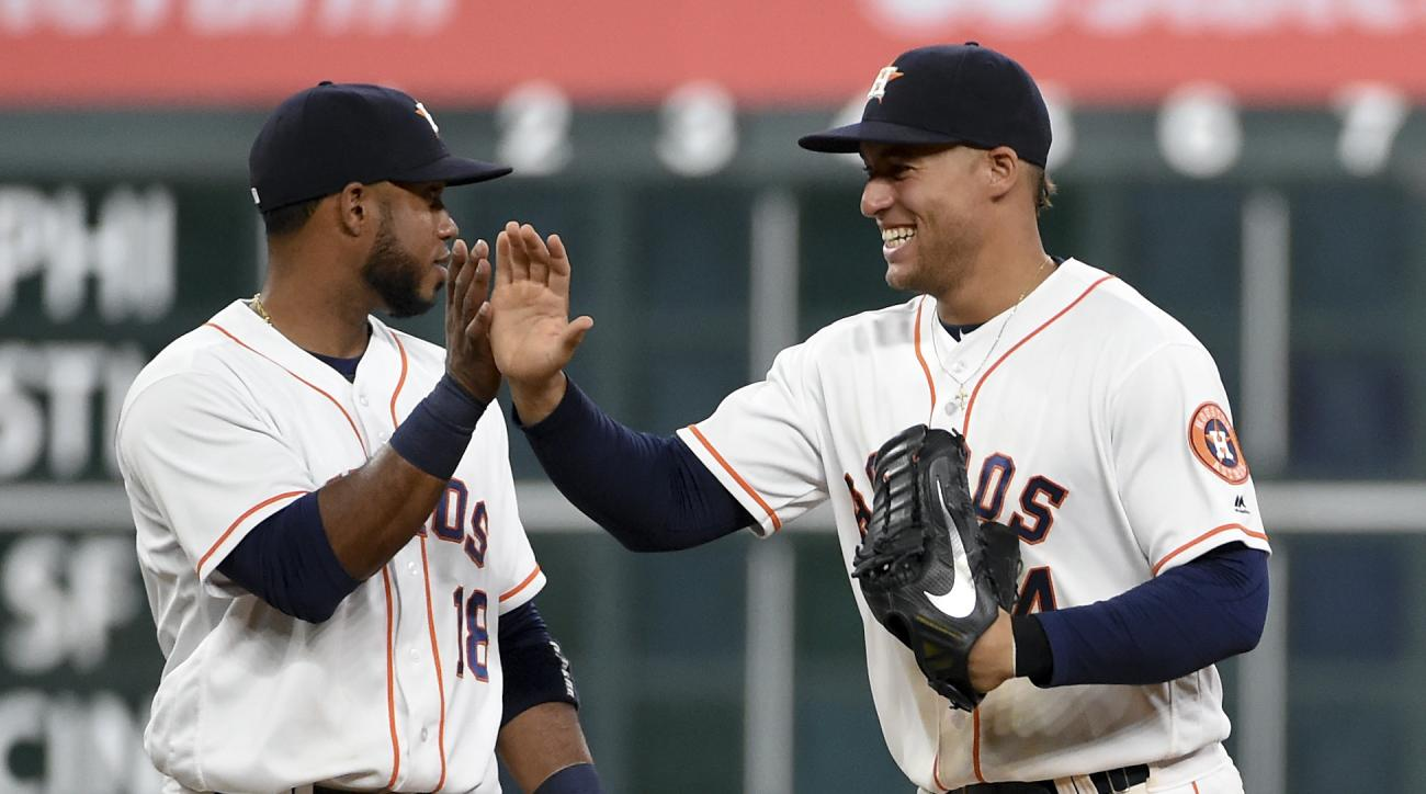Houston Astros' George Springer, right, celebrates the Astros' 16-4 victory over the Minnesota Twins with Luis Valbuena in a baseball game, Wednesday, May 4, 2016, in Houston. (AP Photo/Eric Christian Smith)