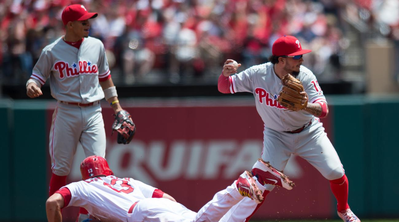 Philadelphia Phillies shortstop Freddy Galvis (13) turns a double play as St. Louis Cardinals' Matt Carpenter (13) is tagged out during the first inning of a baseball game at Busch Stadium on Thursday, May 5, 2016,  in St. Louis. (AP Photo/Michael Thomas)