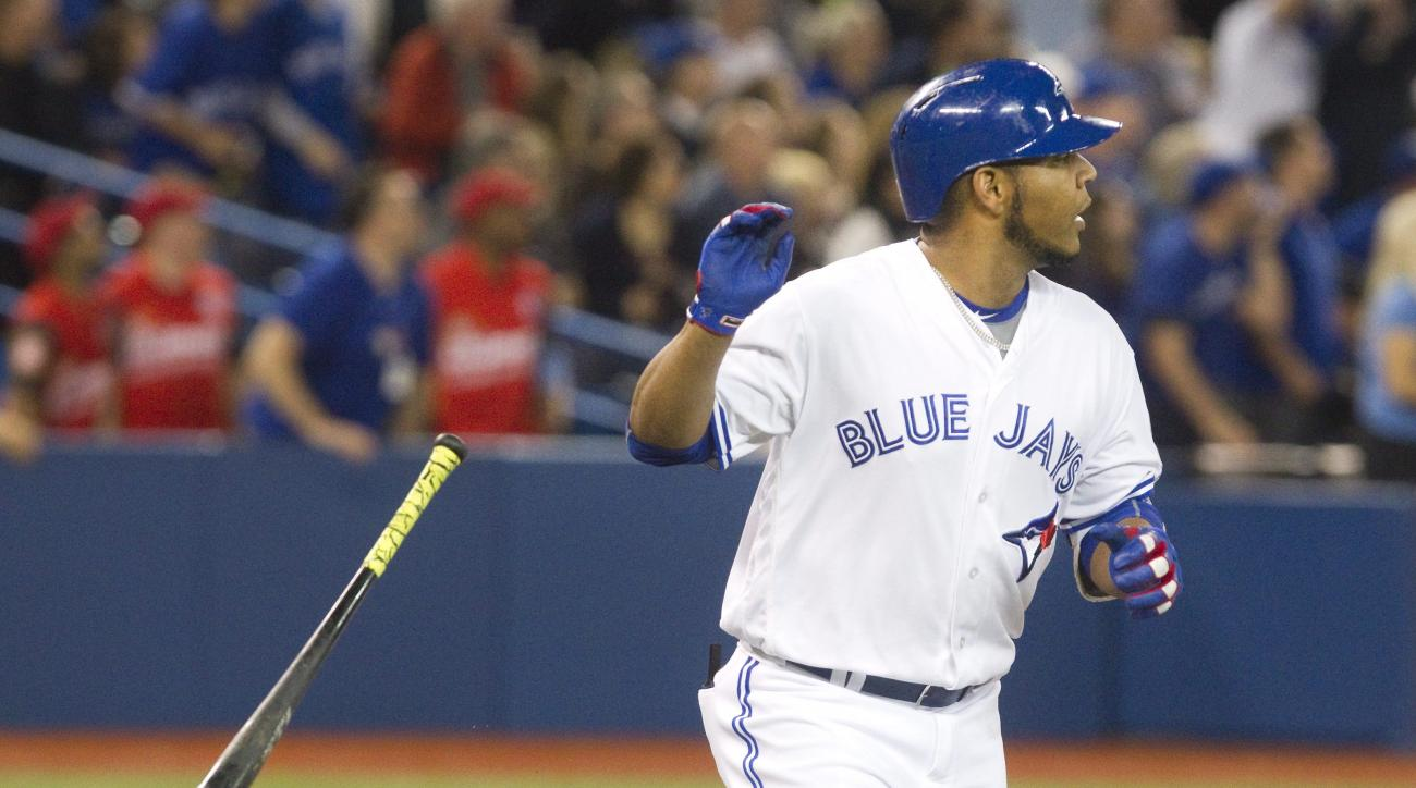 Toronto Blue Jays Edwin Encarnacion tosses his bat after hitting a three run home run against the Texas Rangers in the third inning of their baseball game in Toronto, Thursday, May 5, 2016. (Fred Thornhill/The Canadian Press via AP)