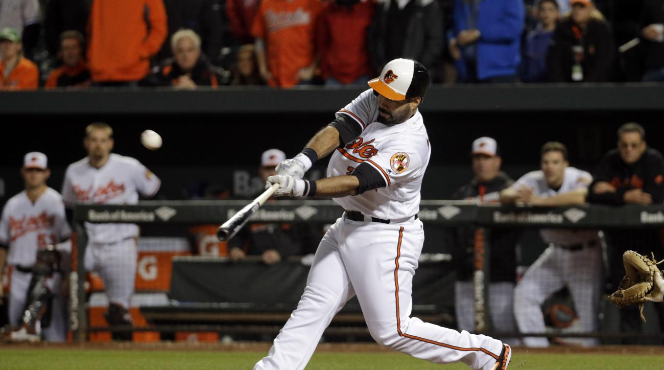 Baltimore Orioles designated hitter Pedro Alvarez hits a sacrifice fly ball in the tenth inning of a baseball game against the New York Yankees in Baltimore, Thursday, May 5, 2016. Nolan Reimold scored on the play, and Baltimore won 1-0. (AP Photo/Patrick
